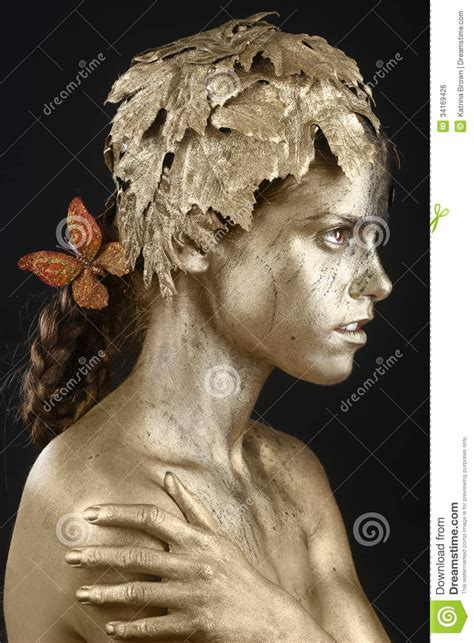Beautiful Gold Painted Woman In Conceptual Beauty Themed
